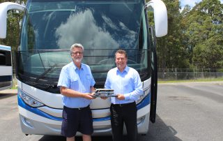 Kennedy's Bus & Coach owner John Kennedy with Volgren sales representative Michael Harris