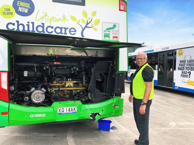 Brian Weller inspecting a bus for repair